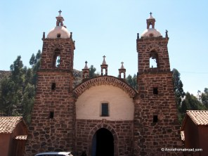 Multi-colored brick church in Raqchi