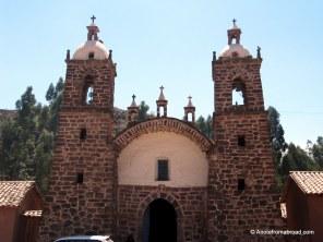 Multi-colored brick church in Raqchi