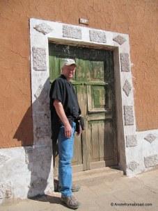 Tim beside colorful door