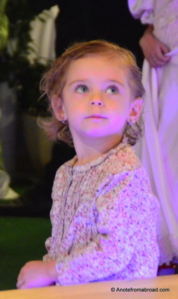 This adorable child looked on with wonder in her eyes at the performers danced