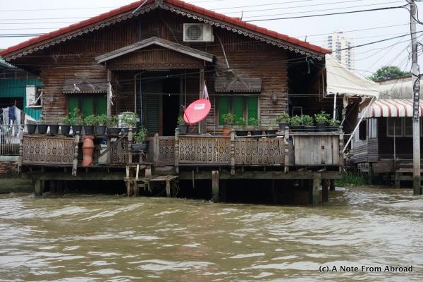 Thai houses along the river edge