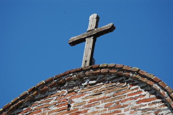 Wooden cross still overshadows the courtyard