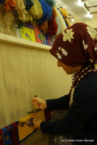 Wool carpet being knotted by hand