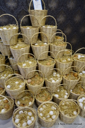 Eggs sold by the basketful, layered with straw