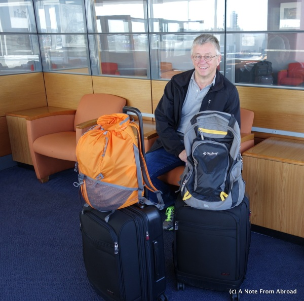 Tim at LAX with all of our luggage.  Two carry on size suitcases and two small backpacks.
