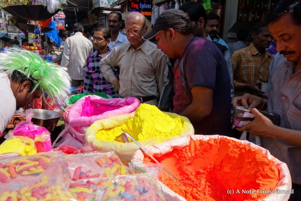 People lined up to buy colored powder and water balloons for Holi Festival