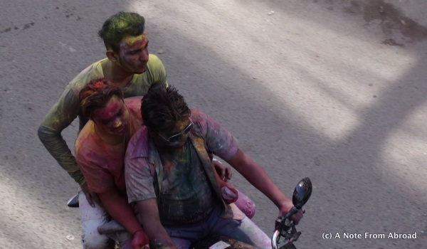 Three or four to a motorcycle is normal.  Covered in dye