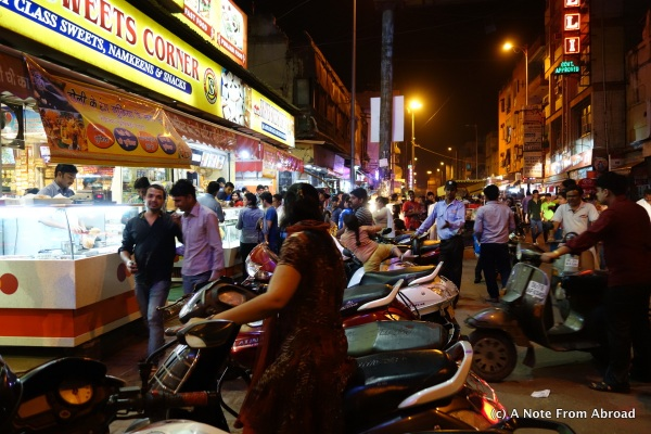 The streets were alive with people, dogs, and motorbikes