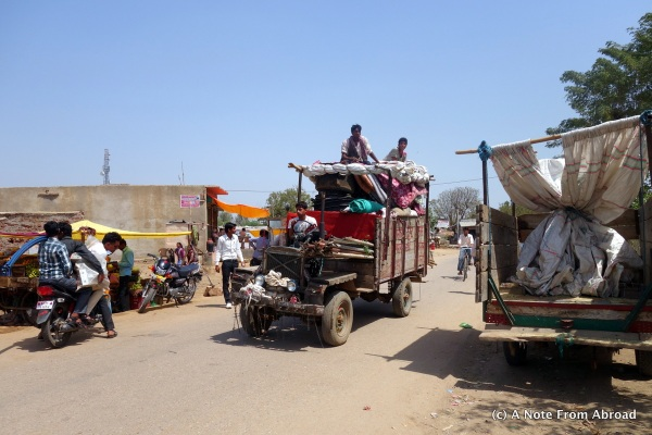 You see people riding on top of cars, wagons, buses, or wherever they can