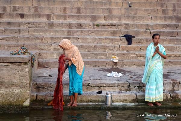 Women praying and preparing to enter the water