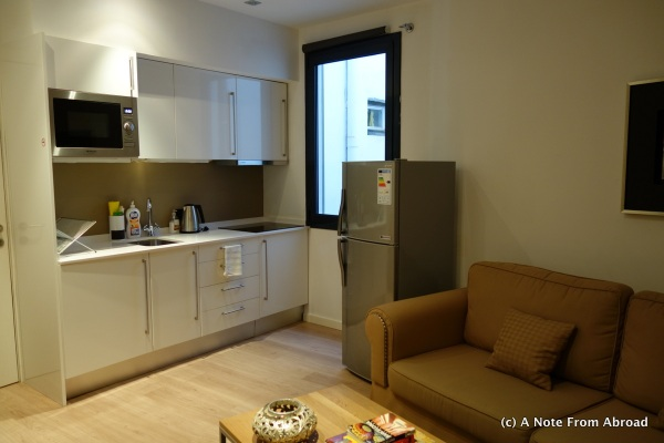 Kitchen area with refrig, microwave, washer/dryer