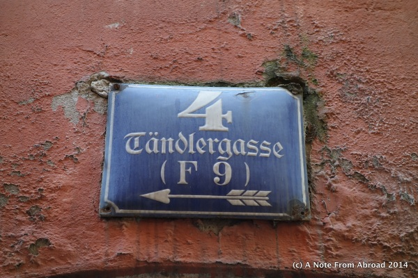 Street sign, address on the side of a building