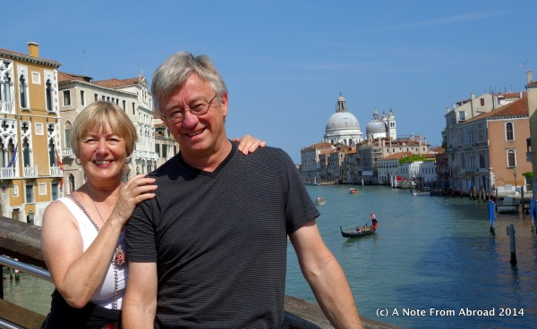 Standing on a bridge over the Grand Canal in Venice