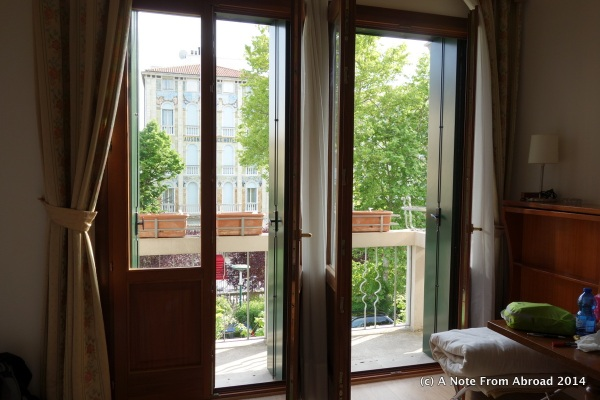 Balcony doors wide open to let in a wonderful breeze
