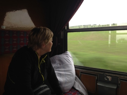 Joanne looking out the window as we approach Prague