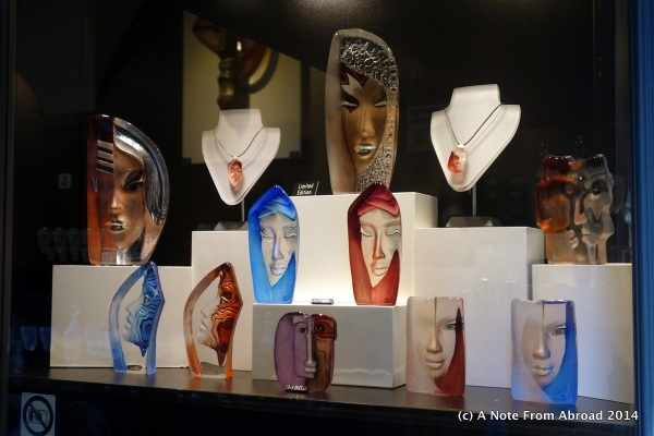 Glass faces in a shop window