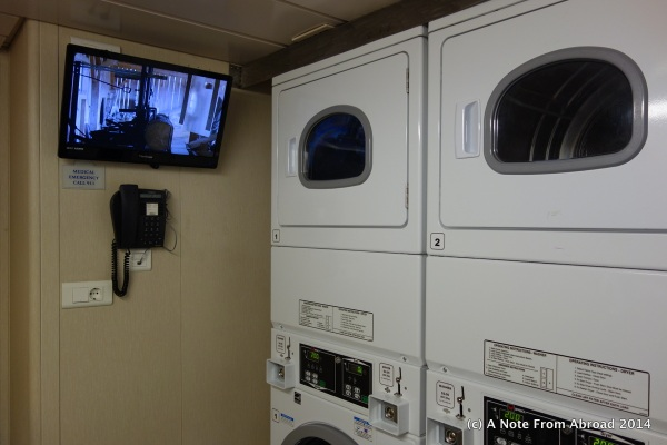 Laundry room complete with a TV