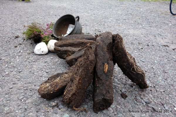 Peat, that is dried and then burned for fuel