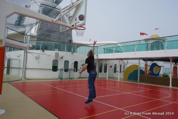 Tim playing basketball on deck