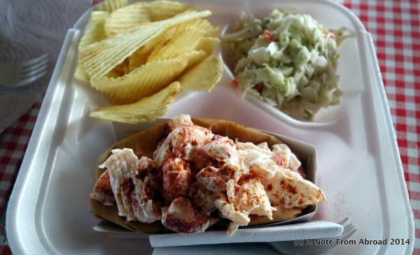 Lobster roll with chips and cold slaw