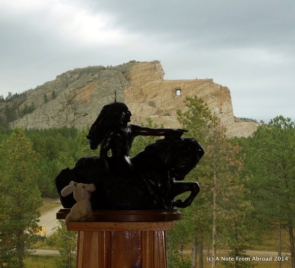 Crazy Horse in background with sculpture lined up to show what finished carving will be