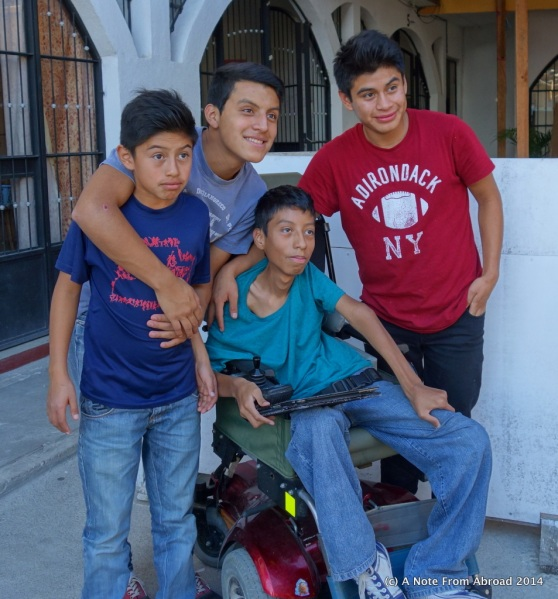 The young man in the center has MS and was provided with a wheel chair.