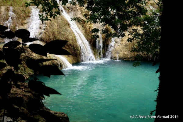 Small waterfalls drop into a turquoise pool