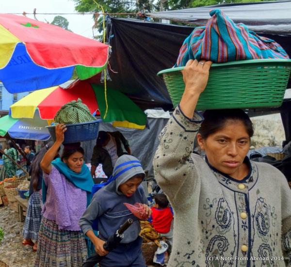 Women carry goods carefully balanced on top of their head