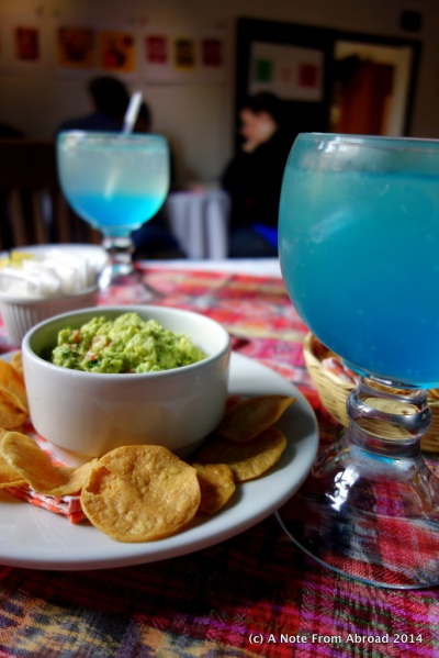 Yummy quacamole and chips with lemonade (not sure why it was blue)