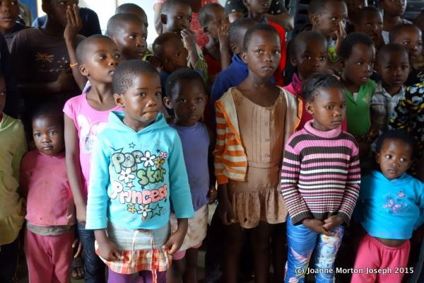 Children welcoming us