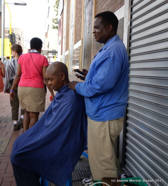 Getting a hair cut right out on the sidewalk