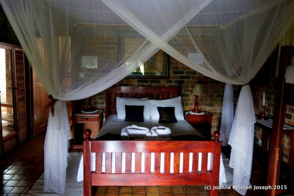 Inside our river front lodge, complete with mosquito netting and an open air shower