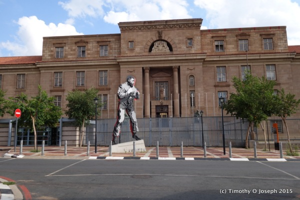 Famous statue of Mandela across the street from his law office