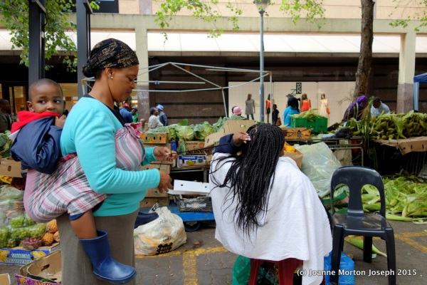 Buy some fruit or get your hair braided in the market place. Hair braiding offered