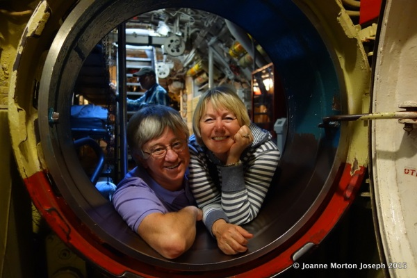 Tim and Joanne in a port-hole opening between compartments