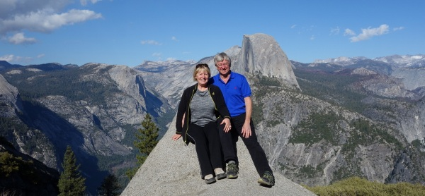 Sitting on a rock at Glacier Point, overlooking the Curry Vilage 3,214 feet below