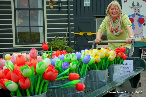 Riding a pushcart to deliver tulips to market.