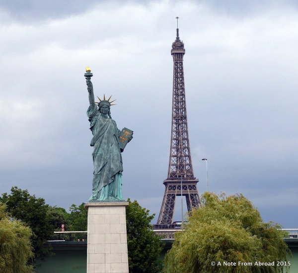 Statue of Liberty with the Eiffel Tower in the background