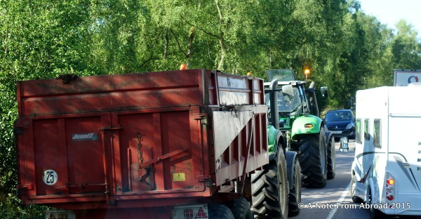 The motorhome gives way and the tractors get through, but are now face to face with oncoming traffic
