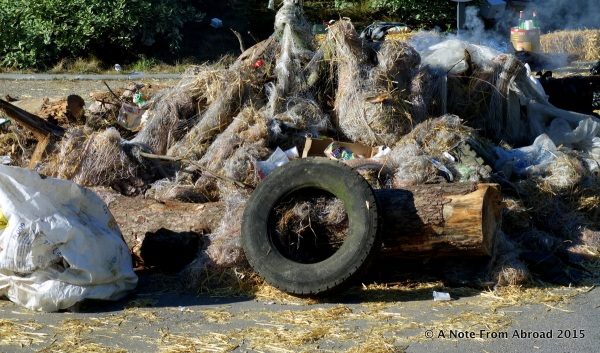 Piled up manure, beef, tires and other trash