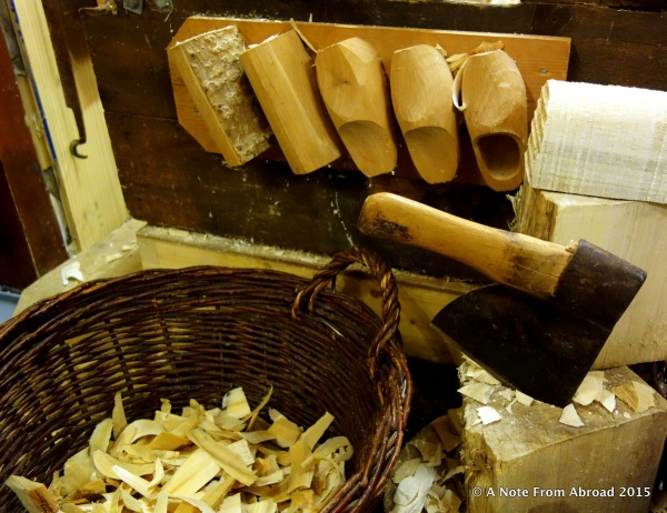 Clog or wooden shoes in various stages of being made by hand