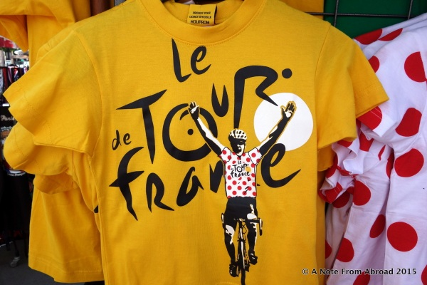 Already t-shirts and other Le Tour de France memorabilia is displayed for sale