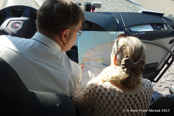 Our driver Gaspar and guide Domonique studying the map trying to find a route to bypass the strike blockages