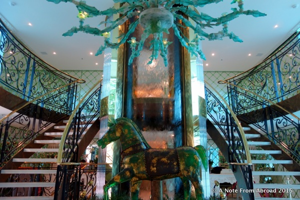 A specially commissioned full size horse statue and hand-blown Murano chandelier welcome us on board the SS Catherine