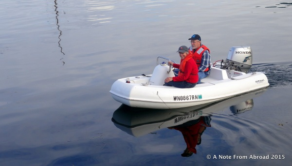 Jan and Mark are in our little dingy, coming back to the boat, after a hike on Cypress Island