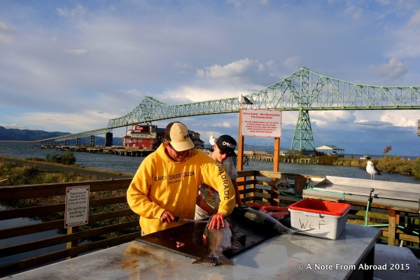 Fishermen cleaning their catch at the Astoria wharf.