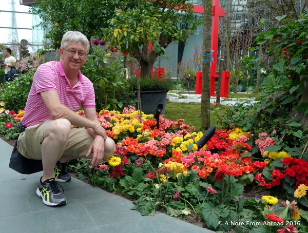 Tim next to one of many colorful flower displays