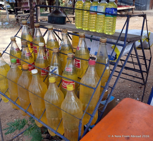 Gasoline being sold roadside in plastic soda bottles