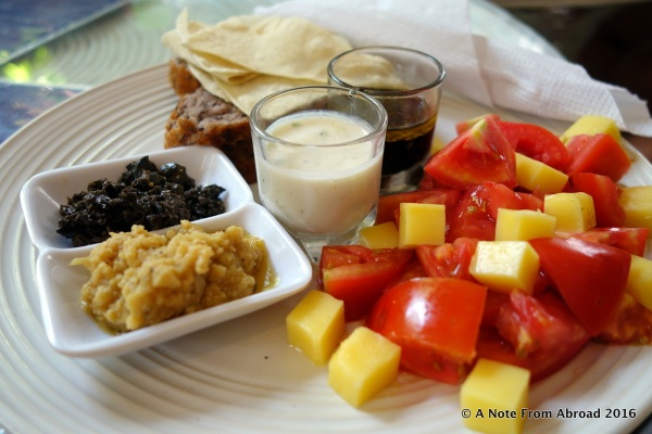 Hummus plus bread, fruit and veggies