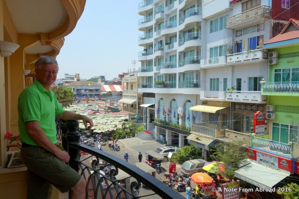 Tim on our balcony at the Ohana Phnom Penh Palace Hotel